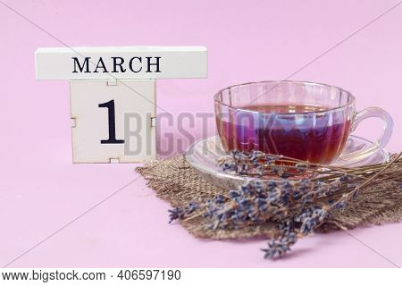 Calendar For March 1 : A Cube With The Number 1 And The Name Of The Month, A Cup Of Tea With A Bouqu