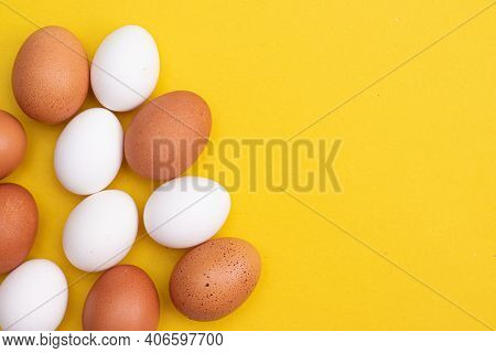 Chicken Eggs On A Yellow Background. Chicken Eggs. Article About Eggs Benefits And Harms. Copy Space