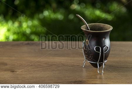 Traditional Mate Made Of Calabash Over A Wooden Table Outdoors. Copy Space. Culture Of South America