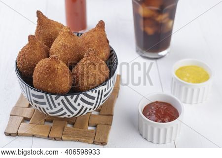 Typical Brazilian Snack Coxinha On A Bowl With Soda Glass.