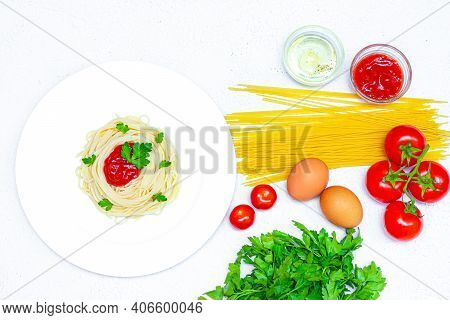 Spaghetti On A Plate With Ketchup And Herbs. Pasta Spaghetti With Vegetables Ketchup From Vegetables