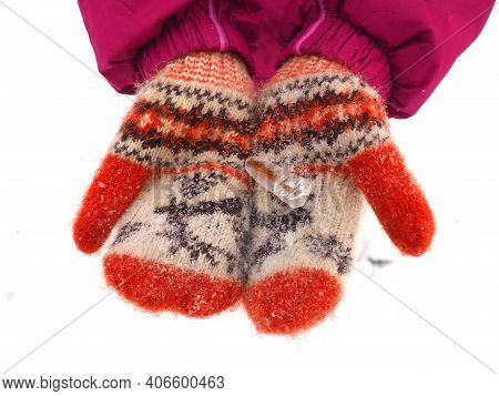 Ice On Mittens Or Gloves. Children's Hands Hold A Frozen Straw In Their Palms. Red Knitted Winter Mi
