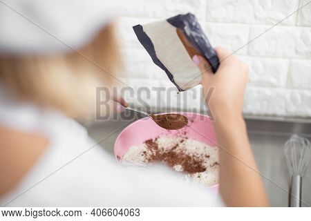 Confectionery Concept. Close Up Back View Of Professional Hands Of Woman Pastry Chef, Adding Cacao P