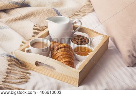 Continental Breakfast In Bed With Coffe, Croissant, Almonds And Jam On Wooden Tray. Good Morning Con
