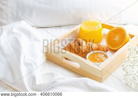 Continental Breakfast In Bed With Croissant, Orange Juice And Jam On Wooden Tray. Good Morning Conce