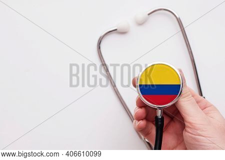 Colombia Healthcare Concept. Doctor Holding A Medical Stethoscope.