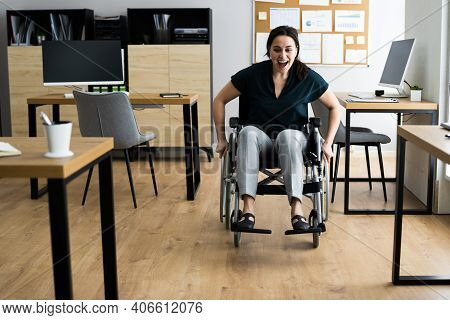 Disabled Handicapped Businesswoman In Wheelchair At Work