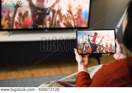 Streaming Tv Movie Using Tablet. Sofa Television Screen