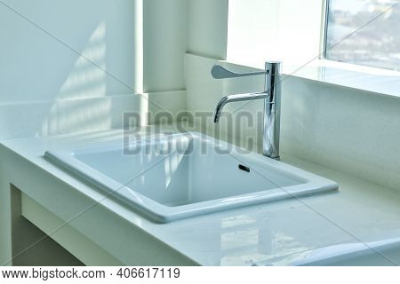 Ceramic Sink And Modern Tap In Stylish Kitchen Interior. Interior Home Styling Classic And Modern Ki