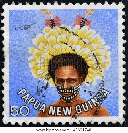 stamp printed in Papua New Guinea shows a man in a feathered headdress from the area near Koiari
