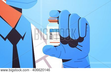 Doctor In Mask Holding Bottle Vial Of Covid-19 Vaccine Injection Vaccination Immunization Anti Coron