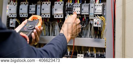 Electrician Engineer Work  Tester Measuring  Voltage And Current Of Power Electric Line In Electical