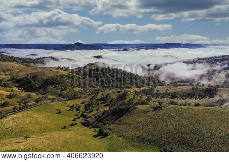 Aerial View Of Low-level Clouds In A Large Green Valley In The Central Tablelands In Regional New So