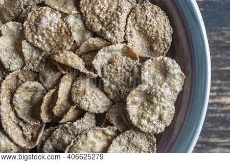 Whole Grain Glazed Flakes In Plate. Healthy Breakfast, Whole Grain Muesli In A Bowl