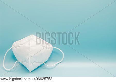 Anti-pollution Mask On Blue Background. Protection White Medical Face Mask For Epidemic Coronavirus