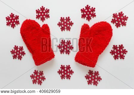 Red Fluffy Kids Mittens With Many Red Wooden Snowflakes On White Background.