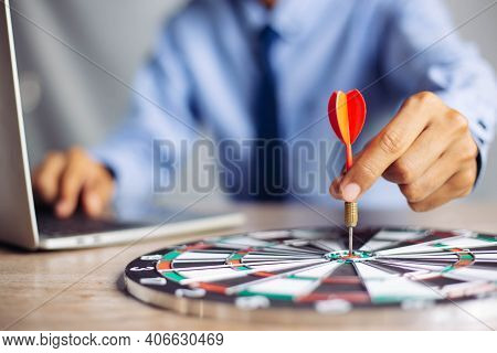 Businessman Holding A Darts Aiming At The Target Center Business Goal Concept - Business Targeting,