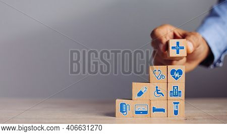 Hand Arranging Wood Block Stacking With Icon Healthcare Medical, Insurance For Your Health Medical,