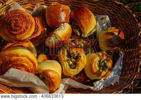 Fresh Mouth-watering Pies Lie In A Basket In The Evening Light. Rural Pastries.