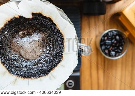 Close Up Coffee Brewing Gadgets On Wooden Bar Counter In Cafe. Barista Hipster Man Pouring Hot Water