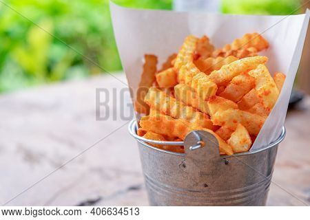 Fresh French Fries In A Basket On The Wooden Table Background. Tasty Fried Potato Chip In A White Pa