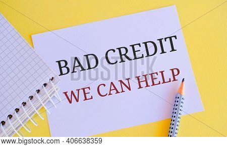 Bad Credit We Can Help Message Written On White Paper. Concept Meaning Borrower With High Risk Debts