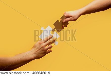 Closeup Hands Of Man Connecting Jigsaw Puzzle. Business Solutions, Success And Strategy Concept. Two