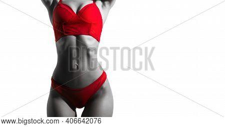 Sexy Woman In Elegant Red Underwear. Athletic Body, Slim Waist, Sexy Girl. The Girl In The Underwear