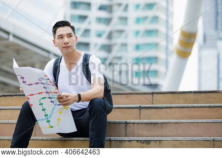 Front View Portrait Of A Handsome Young Adult Asian Man In Casual White Clothes Sitting On Stair, Ho