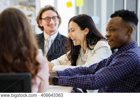 Woman Caucasian Smilling And African American In Meetings About Plans Business At The Meeting Room I