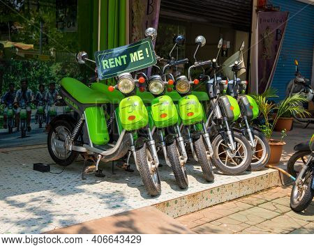 Siem Reap, Cambodia - March 30, 2018: Green Electric Bikes For Rent. Ecological Transport. Bike Rent