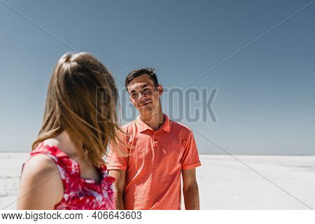 Lovers In The Desert. Couple Walks Along The Trail. The Road To The Far. A Guy With A Girl In A Non-