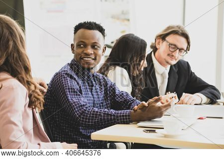 A Man Smilling African American In Meetings About Plans Business At The Meeting Room In The Office.