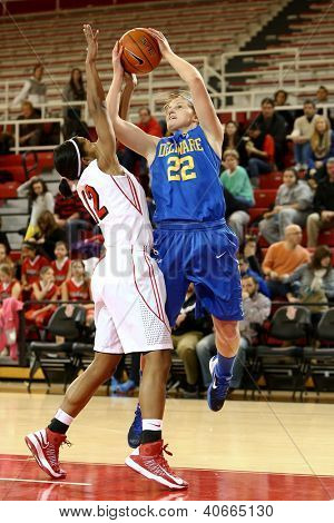 JAMAICA, NY-JAN 2: Delaware Blue Hens guard Lauren Carra (22) shoots over St. John's Red Storm guard Briana Brown (12) at Carnesecca Arena on January 2, 2013 in Jamaica, Queens, New York.