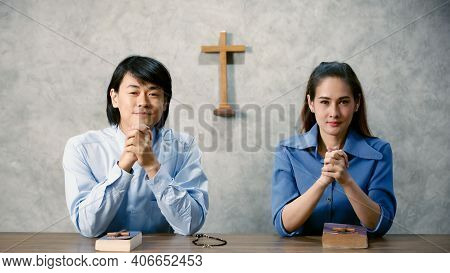 Asian Men And Women Are Going To Pray For The Lord's Blessings At The Minster Of Christianity. It Is