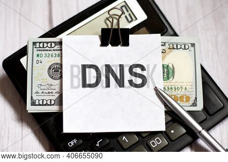 White Paper With Text Dns With Dollars On The Calculator With Pen