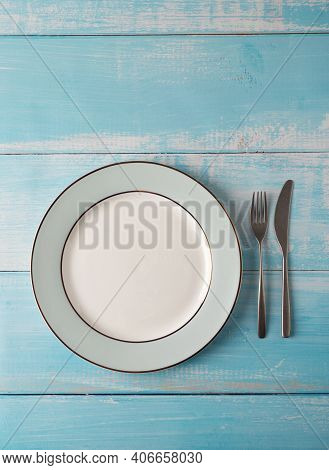 Serving Plate With Silverware At Rural Blue Wooden Background. Top View, Flat Lay, Concept Of Simple