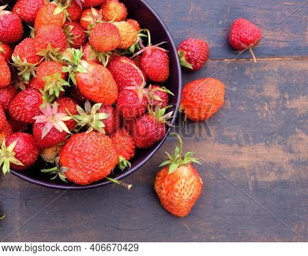 Still Life With Lot Of Ripe Appetizing Strawberries Collected In The Round Bowl On Vintage Wooden Ta