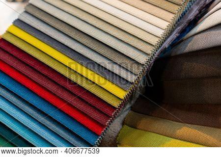 Tissue Catalog. Catalog Of Multi-colored Fabric Samples.