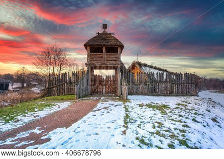 Beautiful sunset over the settlement of Trade Factory in Pruszcz Gdanski at winter, Poland.