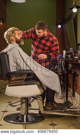 Cool And Trendy. Hairstylist In Barbershop. Man In Hair Salon With Hipster Haircut. Beard And Mustac
