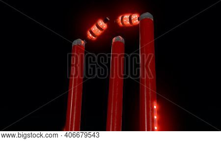Red Electronic Cricket Wickets With Dislodging Bails And Illuminating Led Lights On A Night Sky Back