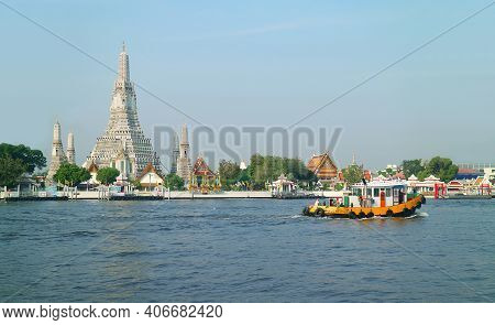 Impressive View Of Wat Arun Or The Temple Of Dawn On The Chao Phraya River Bank, Thonburi District,