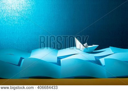 Paper Ship In The Paper Sea. Concept Of The Theme Of Bureaucracy. Copy Space.