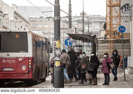 Belgrade, Serbia - January 16, 2021: Crowd Of Persons, Young And Old, Men And Women, Waiting A Bus A