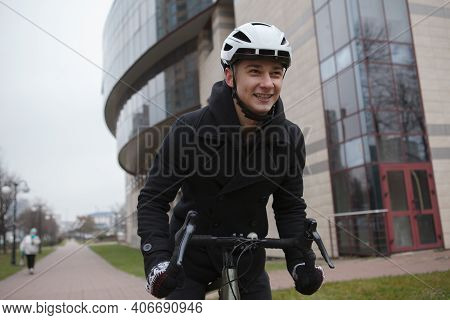 Happy Man Laughing, Enjoying Cycling In The City In Autumn Or Winter