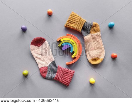 Odd Socks Day.mismatched Socks, Wooden Rainbow And Toy Figures. Social Initiative Against Bullying I