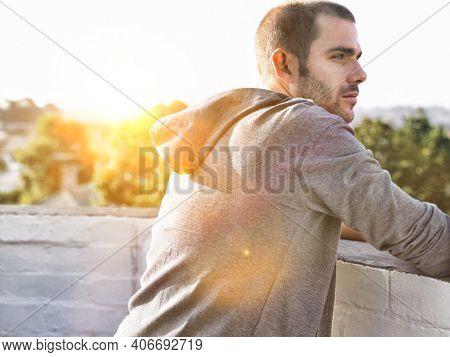Portrait of man contemplating after jogging