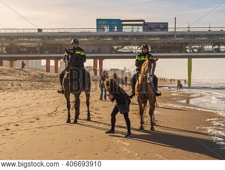 Scheveningen, The Hague, The Netherlands, 22 January 2021: Two Policemen Riding A Horse On A Beach I