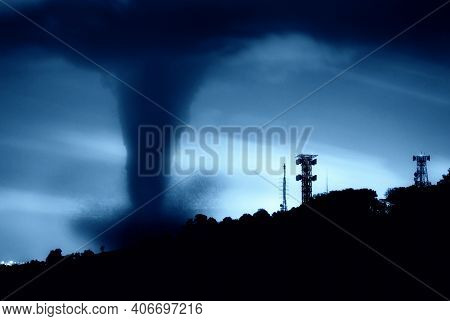 Sky With Epic Dramatic Storm Clouds Over A Tornado. A Very Strong Black Tornado That Rose Into The S